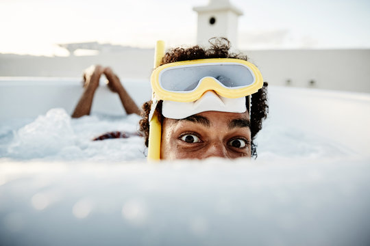 boy in pool with swimming goggles