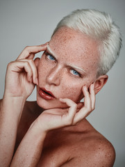 nude beauty with freckles and short white hair