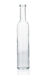Empty glass bottle closeup on white background