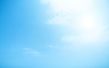 ..Blurry Cloudy blue sky abstract background with sun beam.