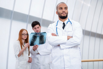 Portrait of a successful doctor. Two confident doctor examining