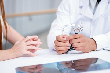Doctor holding a stethoscope in his hand. Doctor talking with th