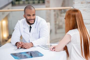 Healthy Life. Doctor talking with the patient while sitting at a