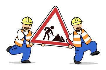 Bauarbeiter tragen Schild zur Baustelle