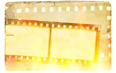 Vintage film strip frame on old paper background. Flames and fire light effect.