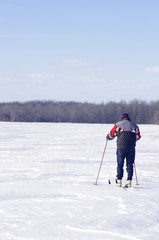 man cross country skiing in field