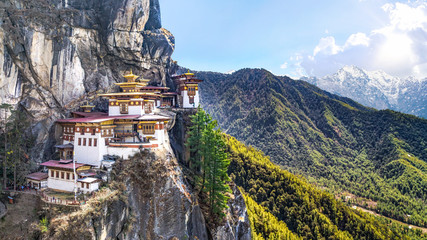 Poster Temple Taktshang Goemba or Tiger's nest Temple or Tiger's nest monastery the beautiful buddhist temple.The most sacred place in Bhutan is located on the high cliff mountain with sky of Paro valley, Bhutan.