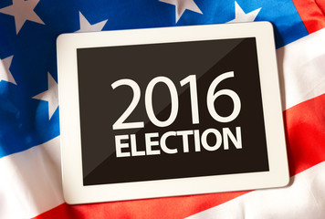 2016 Election on tablet and the US flag