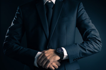 Businessman in Black Suit on Isolated Background
