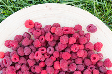pile of raspberries in a bowl close up