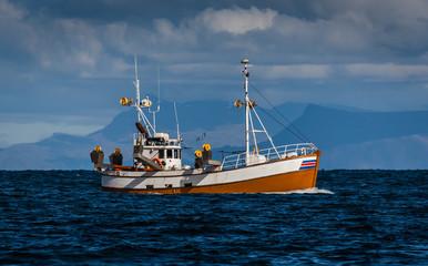 Old fishing boat on mackerel fishing near the southwest coast of Iceland.