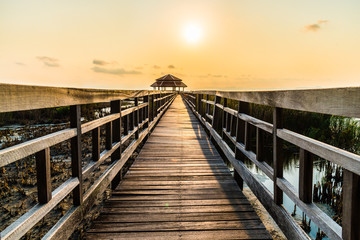 Wood bridge in sunset time at Sam Roi Yot National Park, Thailand
