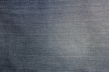 Dark jeans texture background gray black dark blue and white denim natural pattern worn fabric clothes with diagonal lines and stitches
