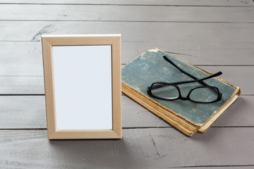 Blank wooden picture frame on wooden background