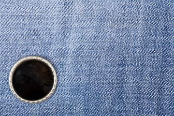 Black buttons on denim