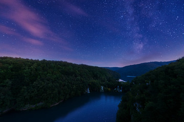 Plitvice Lakes National Park waterfalls at night with Milky Way and beautiful starry sky