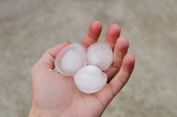 Hail ice in hand after a heavy storm