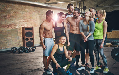 Group of eight athletic young adults in gym
