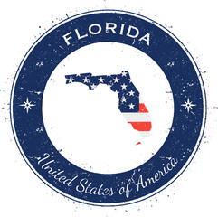 Florida circular patriotic badge. Grunge rubber stamp with USA state flag, map and the Florida written along circle border, vector illustration.