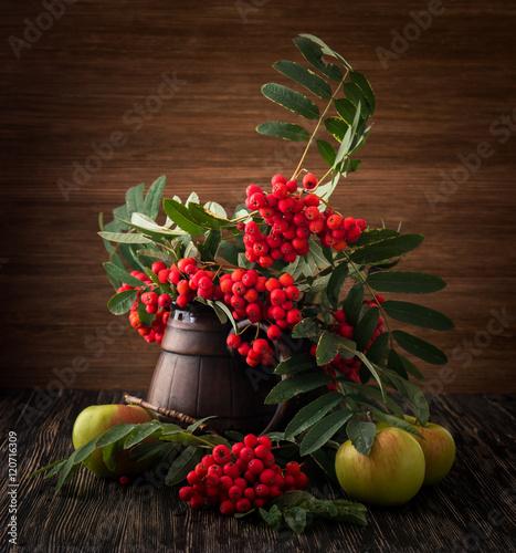 Still Life With Vase Flowers Fruit Rowan On Wood Background