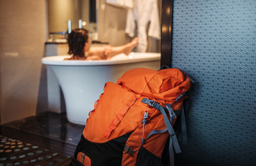 Woman backpacker traveler take a bath in high quality hotel