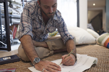 Young man writing music