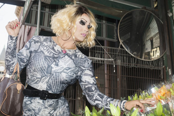 Drag queen at a flower market