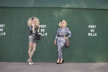 Two drag queens posing together