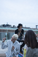 Friends hanging out on a building rooftop