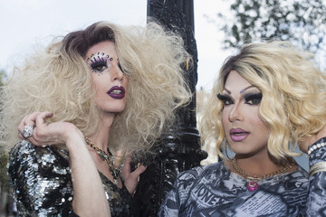 Portrait of two drag queens standing outdoors
