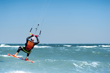 young man kiting in clear blue water
