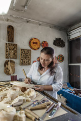 Woodcarving artisan in whittling workshop