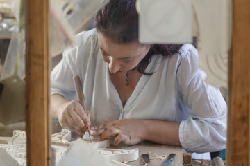 Bulgarian artisan focused on whittling traditional woodwork