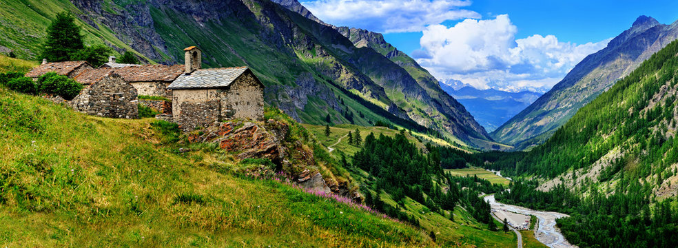 The old architecture with mountains on the panoramic view in Aosta
