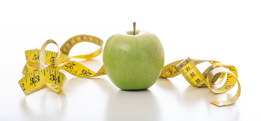Green apple and a measuring tape