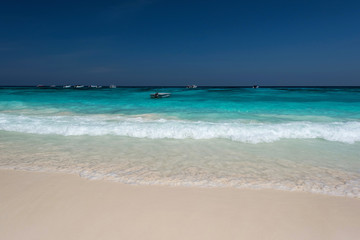 Wall Mural - Water clear at the exotic beach with blue sky