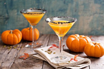 Pumpkin martini cocktail with black salt rim