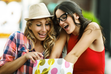 Beautiful young women enjoying shopping.