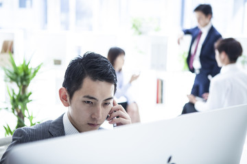 Businessman on the phone in the office of the seat