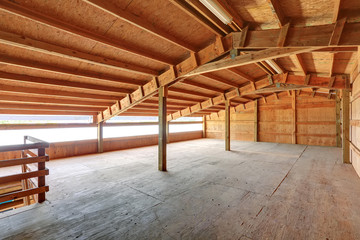 Empty barn inside with wooden trim
