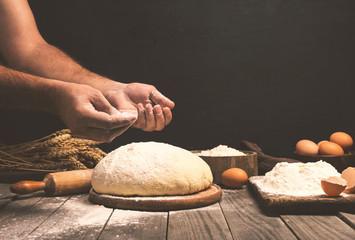 Wall Mural - Man preparing bread dough