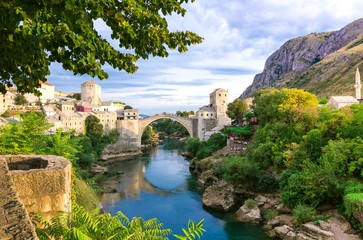 Beautiful landscape of the historic town of Mostar in the lights of the sunset, valley of the Neretva River