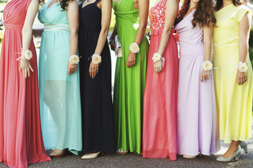 Happy bridesmaids in multicolored dresses