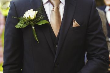 Stylish groom in dark suit