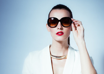 Fashion portrait of woman wearing sunglasses.