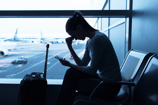 Stressed out female traveler at the airport.