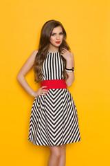 Cheerful Elegant Woman In Striped Dress