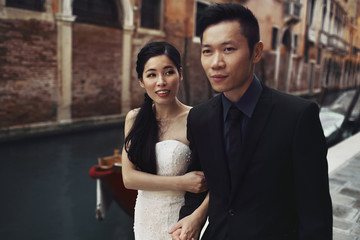 Stylish happy newlyweds in Venice