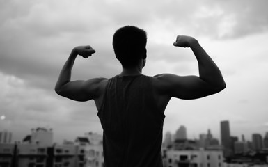 Man flexing his muscle. Winning and life goals concept.