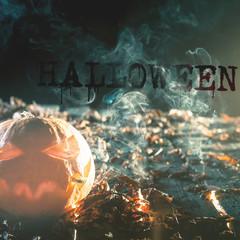 Cool pumpkin smoking a cigarette at halloween